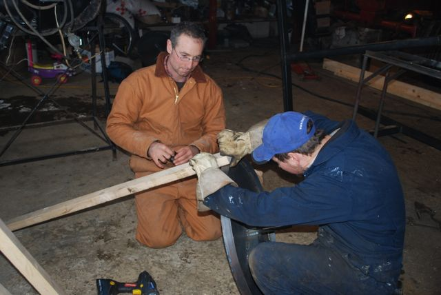 Isaac Villeneuve showing David how to build the root crop washer.